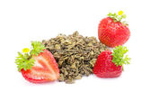 Green fruit tea with strawberries on white — Stock Photo