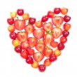 Cherries and strawberries in heart shape — Stock Photo
