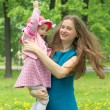 Young mother with child outside on a summer day — Stock Photo #11613274