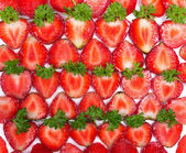 Fresh strawberry slices background — Stock Photo