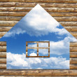 Wooden house icon on blue sky background — Stock Photo