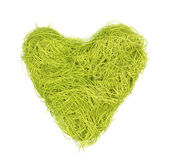 Green heart made of strings on a white background — Stock Photo