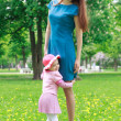 Mother and her daughter in the park — Stock Photo