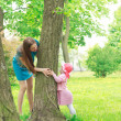 Mother and daughter playing hide and seek — Stock Photo
