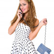 Beautiful pinup girl talking on the phone, isolated — Stock Photo