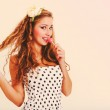 Pretty young woman with blond hair with lollipop. Toned in retro — Stock Photo