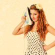 Beautiful pin up girl with iron, toned in retro style — Stock Photo #11961544