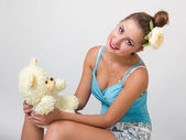 Young pin up woman with teddy bear — Stock Photo
