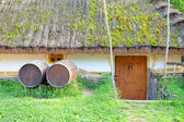 Old rural tavern with wooden barrels — Stock Photo