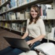 Teen at the library - Stock Photo