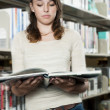Teen at the library — Stock Photo