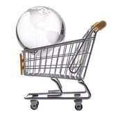 Isolated shopping cart and globe on the white — Photo