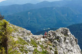 Woman hiker hight in Alps — Stok fotoğraf