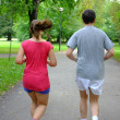 Caucasicouple jogging in summer park. — Foto Stock #12386081
