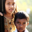 Indian girl with little boy — Stock Photo