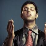 Praying Indian young businessman — Stock Photo #12075828