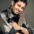 An Indian guitar player - Stock Photo
