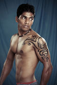 A muscular Indian man with body painting — Stock Photo