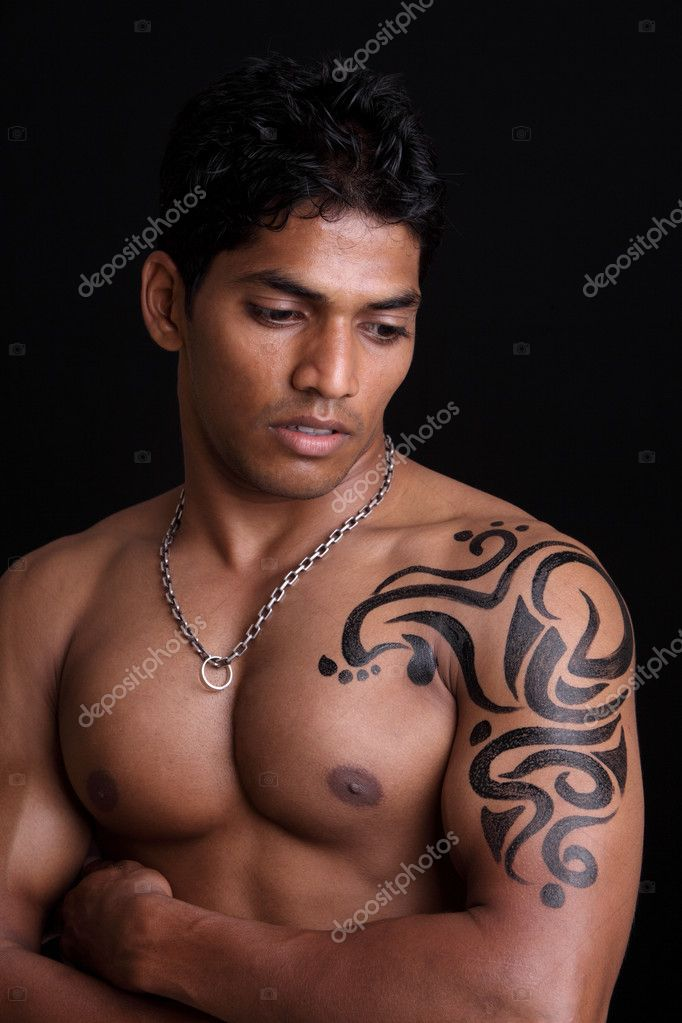A muscular Indian man with body painting — Stock Photo ...