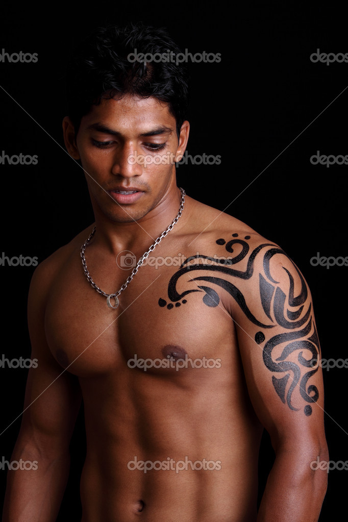 stock photo a muscular indian man in casual clothing on black black