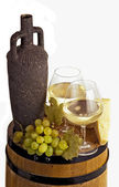 Wineglass with white wine and bottle — Stock Photo
