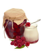 Raspberry jam in a jars and fresh berries — Stock Photo