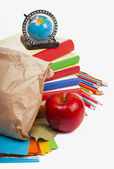 Paper lunch bag with red apple — Stock Photo