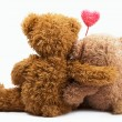 Teddy Bears with pink love heart — Stock Photo #12157118
