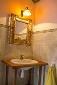 Empty bathroom decorated in a retro style — Stock Photo