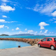 Car on tropical beach - Stock Photo