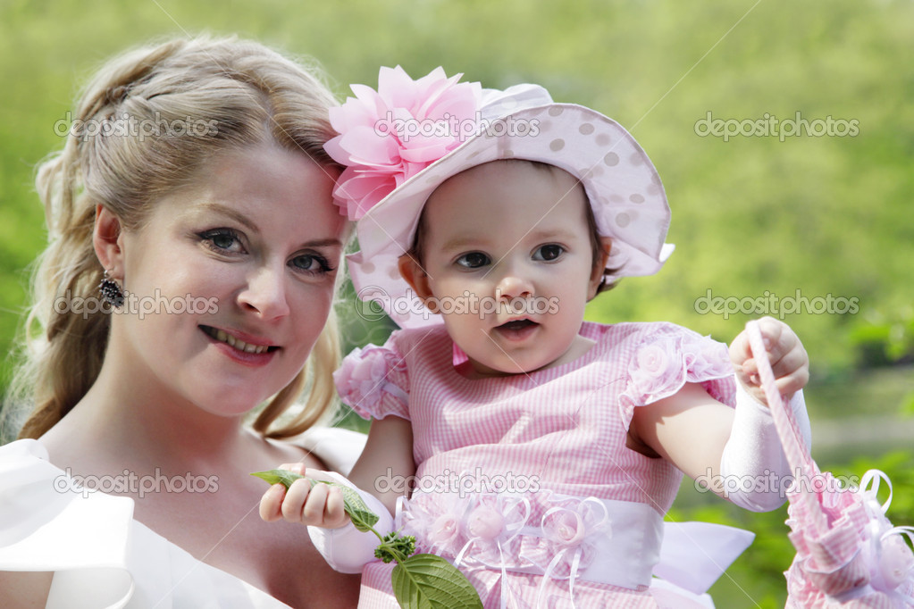 Portrait of beautiful happy smiling mother with baby outdoor, on nature  Stock Photo #10949225