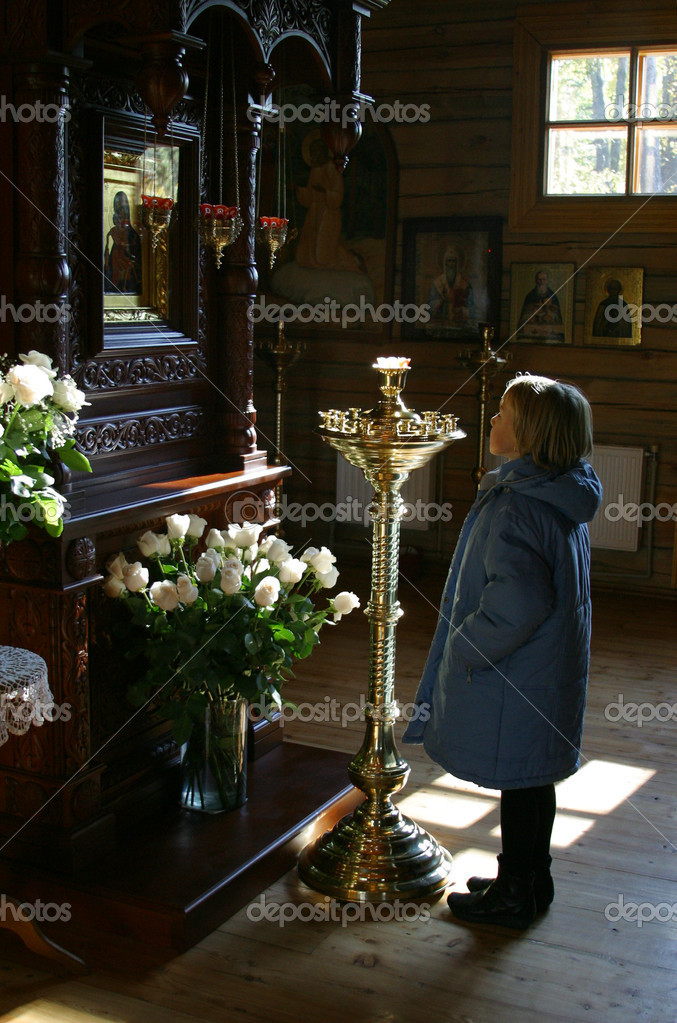 The little girl in church — Stock Photo #11090873