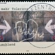 GERMANY - CIRC2002: stamp printed in Germany dedicated to for more tolerance, shows wall painted with word tolerance, circ2002 — Stock Photo #10893302