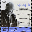 Постер, плакат: GERMANY CIRCA 2001: A stamp printed in Germany shows Werner Heisenberg circa 2001