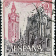 SPAIN - CIRCA 1965: A stamp printed in Spain shows Cathedral and Giralda, Sevilla, circa 1965 — 图库照片