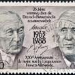 Постер, плакат: FRANCE CIRCA 1988: A stamp printed in France dedicated to 25th anniversary of the Franco German Cooperation Treaty shows the Konrad Adenauer and Charles de Gaulle circa 1988