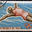 Foto de Stock  : MALI - CIRC1965: stamp printed in Mali shows Swimmer, circ1965