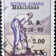 PERU - CIRCA 1969: A stamp printed in Peru dedicated to agrarian reform, shows a farmer punching a hole with a shovel, circa 1969 — Lizenzfreies Foto