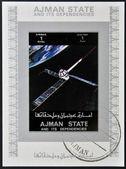 AJMAN STATE - CIRCA 1973: A stamp printed in United Arab Emirates (UAE) shows Explorer 22 / 27 series satellites, circa 1973 — Foto de Stock