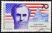 GERMANY - CIRCA 1976: a stamp printed in the Germany shows Carl Schurz, American Flag and Capitol, circa 1976 — Stock Photo