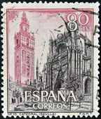 SPAIN - CIRCA 1965: A stamp printed in Spain shows Cathedral and Giralda, Sevilla, circa 1965 — Stock fotografie