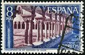 SPAIN - CIRCA 1973: A stamp printed in spain shows Cloister of Monasterio de Santo Domingo de Silos, Burgos, circa 1973SPAIN - CIRCA 1973: A stamp printed in spain shows Cloister of Monasterio de Sant — Stock Photo