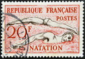 FRANCE - CIRCA 1953: a stamp printed in the France shows Swimming, circa 1953 — Foto Stock