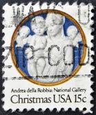 Estados declarado de america - circa 1978: um selo impresso, eua, mostra madonna e criança com querubins, andrea della robbia, circa 1978 — Foto Stock