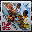 Stock Photo: BURUNDI - CIRC1967: stamp printed in Burundi shows Scouts preparing meal, circ1967