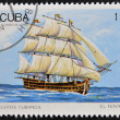 Royalty-Free Stock Photo: CUBA - CIRCA 1989: A Stamp printed in Cuba shows image of Cubans sailing, El Fenix, circa 1989