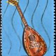 "GREECE - CIRCA 1975: A stamp printed in Greece dedicated to the '""traditional musical instruments""  shows a lute (laouto), circa 1975. — Stock Photo"