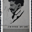 图库照片: IRELAND - CIRC1971: stamp printed in Eire shows J.m.synge Playwright, circ1971