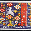 Stock Photo: ROMANI- CIRC1975: stamp printed in Romania, show RomaniPeasant Rugs, circ1975.