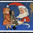 UNITED KINGDOM - CIRCA 1997: A stamp printed in Great Britain showing Children and Father Christmas pulling a Christmas Cracker, circa 1997 — Foto de Stock